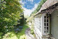 BNPS.co.uk (01202 558833)<br /> Pic:  Riverhomes/BNPS<br /> <br /> Pictured: The view of the garden from the top of the spiral staircase.<br /> <br /> A striking Victorian boathouse that has been used as a film set is on the market for £2m.<br /> <br /> The time capsule building by the River Thames was used in a film version of The Wind in the Willows and the 1996 film True Blue, about the Oxford Cambridge boat race.<br /> <br /> It has an enclosed mooring as well as two moorings on the bank, perfect for those who want to spend their days messing about in boats like Ratty and Mole.