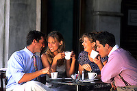 Two young couples age 30s having coffee together in caf?à laughing