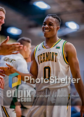16 March 2019: University of Vermont Catamount Guard Stef Smith, a Sophomore from Ajax, Ontario, smiles with the lead well in hand, as he returns to the bench in the second half against the UMBC Retrievers in the America East Championship Game at Patrick Gymnasium in Burlington, Vermont. The Catamounts defeated the Retrievers 66-49, avenging their loss against the same team in last years' Championship Game. Mandatory Credit: Ed Wolfstein Photo *** RAW (NEF) Image File Available ***