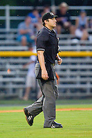 Home plate umpire Evan Barger walks out to the mound to break up a meeting during the Appalachian League game between the Bristol White Sox and the Burlington Royals at Burlington Athletic Park on July 6, 2012 in Burlington, North Carolina.  The Royals defeated the White Sox 5-2.  (Brian Westerholt/Four Seam Images)