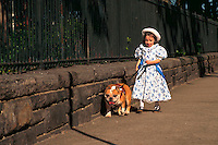 Little girl walking an activity therapy dog.
