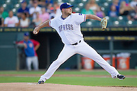 Round Rock Express pitcher Evan Meek (47) delivers a pitch to the plate against the Iowa Cubs in the Pacific Coast League baseball game on July 21, 2013 at the Dell Diamond in Round Rock, Texas. Round Rock defeated Iowa 3-0. (Andrew Woolley/Four Seam Images)