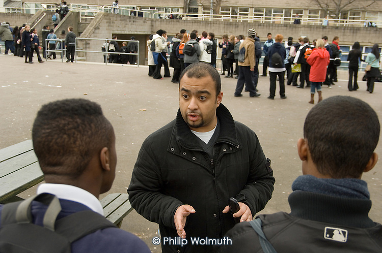 Jabir Uddin, Youth and Community Manager of the Extended School Programme at George Green Secondary School, Isle of Dogs, Tower Hamlets, deals with a playground confrontation.