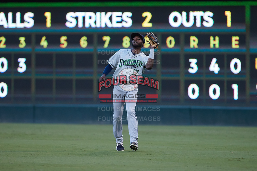 Gwinnett Stripers right fielder Travis Demeritte (12) catches a fly ball during the game against the Charlotte Knights at Truist Field on July 17, 2021 in Charlotte, North Carolina. (Brian Westerholt/Four Seam Images)