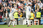 Sergio Ramos of Real Madrid celebrates with teammate Lucas Vazquez during their La Liga 2016-17 match between Real Madrid and Malaga CF at the Estadio Santiago Bernabéu on 21 January 2017 in Madrid, Spain. Photo by Diego Gonzalez Souto / Power Sport Images
