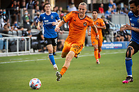 SAN JOSE, CA - JULY 24: Griffin Dorsey #25 of the Houston Dynamo dribbles the ball during a game between San Jose Earthquakes and Houston Dynamo at PayPal Park on July 24, 2021 in San Jose, California.