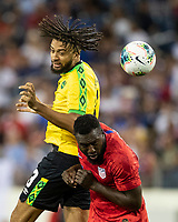 NASHVILLE, TN - JULY 3: Michael Hector #3 gets a header over Jozy Altidore #17 during a game between Jamaica and USMNT at Nissan Stadium on July 3, 2019 in Nashville, Tennessee.