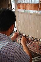 Kashmiri carpet maker at work on the complex pattern of knots that make up each  stunning piece, Srinagar, Kashmir, India.