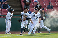 Kane County Cougars pinch runner Jorge Perez (16) and Zack Shannon (18) celebrate a victory after a Midwest League game against the Cedar Rapids Kernels at Northwestern Medicine Field on April 28, 2019 in Geneva, Illinois. Kane County defeated Cedar Rapids 3-2 in game one of a doubleheader. (Zachary Lucy/Four Seam Images)