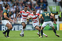 Male Sa'u of Japan takes on the South Africa denfece. Rugby World Cup Pool B match between South Africa and Japan on September 19, 2015 at the Brighton Community Stadium in Brighton, England. Photo by: Patrick Khachfe / Stewart Communications