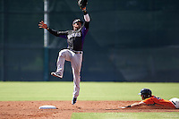 Colorado Rockies Jonathan Piron (3) jumps to make the catch as Seth Harrison (45) slides safely into second during an instructional league game against the San Francisco Giants on October 7, 2015 at the Giants Baseball Complex in Scottsdale, Arizona.  (Mike Janes/Four Seam Images)