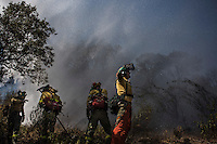 Firefighters of Brica´s Malaga 703 of the service of Andalucian Infoca plan work in the wildfire in El Ronquillo, near Sevilla on July 26, 2015.<br /> Since July 19 wildfires have ravaged nearly 39,000 hectares of land in Spain, according to the provisional figures from the agriculture ministry. © Pedro ARMESTRE