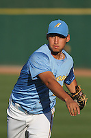 Myrtle Beach Pelicans pitcher Randol Rojas #19 warming up in the outfield before a game against the Frederick Keys at Tickerreturn.com Field at Pelicans Ballpark on April 24, 2012 in Myrtle Beach, South Carolina. Frederick defeated Myrtle Beach by the score of 8-3. (Robert Gurganus/Four Seam Images)