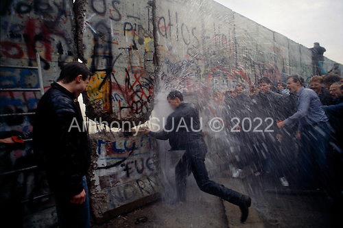 West Berlin, West Germany<br /> November 11, 1989<br /> <br /> East German police spray water from a water canon on West Germans as they break through the wall at the Brandenburg Gate. The East German government lifts travel and emigration restrictions to the West on November 9, 1989.