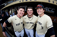 (L-R) Chris Lanzilli (24), Michael Ludowig (22), and Bobby Seymour (3) prior to the game against the Notre Dame Fighting Irish at David F. Couch Ballpark on March 10, 2019 in  Winston-Salem, North Carolina. The Demon Deacons defeated the Fighting Irish 7-4 in game one of a double-header.  (Brian Westerholt/Four Seam Images)
