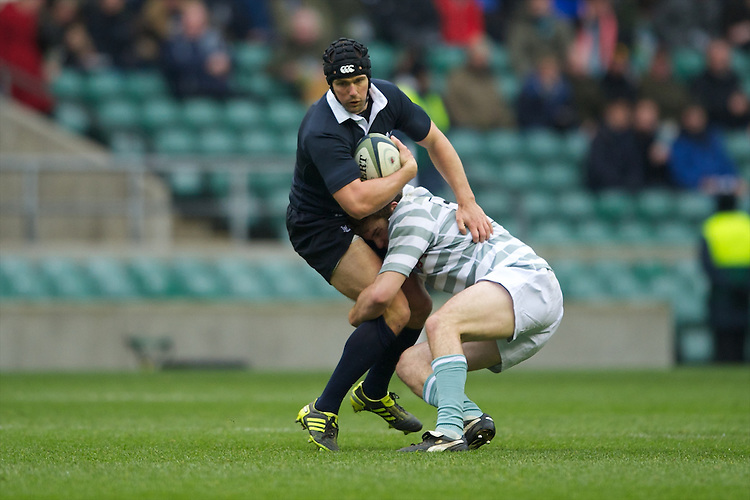 Gavin Turner of Oxford University is tackled by Danny Holmes of Cambridge University during the 131st Varsity Match between Oxford University and Cambridge University at Twickenham on Thursday 06 December 2012 (Photo by Rob Munro)