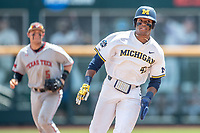 Michigan Wolverines designated hitter Jordan Nwogu (42) runs to third base during Game 11 of the NCAA College World Series against the Texas Tech Red Raiders on June 21, 2019 at TD Ameritrade Park in Omaha, Nebraska. Michigan defeated Texas Tech 15-3 and is headed to the CWS Finals. (Andrew Woolley/Four Seam Images)