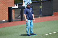 Old Dominion Monarchs head coach Chris Finwood coaches third base during the game against the Charlotte 49ers at Hayes Stadium on April 25, 2021 in Charlotte, North Carolina. (Brian Westerholt/Four Seam Images)