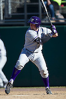 Washington Huskies third baseman Alex Schmidt (27) at bat during the NCAA season opening baseball game against the Air Force Falcons on February 14, 2014 at Bobcat Ballpark in San Marcos, Texas. Air Force defeated Washington 14-9. (Andrew Woolley/Four Seam Images)