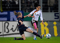 Heather O'Reilly slide ackles Fatmire Bajramaj (19). US Women's National Team defeated Germany 1-0 at Impuls Arena in Augsburg, Germany on October 29, 2009.