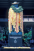 Lei-draped statue of Father Damien in downtown Honolulu. Historically important to Hawaiian history, Father Damien founded the leper colony on the island of Molokai in the 1800's.