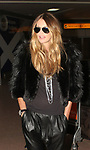 Elle Macpherson arriving at Glasgow Airport for Britains next top model