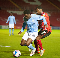 Lincoln City's Tayo Edun battles with Manchester City U21's Oluwatimilehin Sobowale<br /> <br /> Photographer Andrew Vaughan/CameraSport<br /> <br /> EFL Papa John's Trophy - Northern Section - Group E - Lincoln City v Manchester City U21 - Tuesday 17th November 2020 - LNER Stadium - Lincoln<br />  <br /> World Copyright © 2020 CameraSport. All rights reserved. 43 Linden Ave. Countesthorpe. Leicester. England. LE8 5PG - Tel: +44 (0) 116 277 4147 - admin@camerasport.com - www.camerasport.com