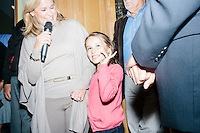 """Heidi Nelson Cruz, wife, stands next to her daughter, Caroline, while speaking to attendees before Texas senator and Republican presidential candidate Ted Cruz speaks at an event called """"Smoke a cigar with Ted Cruz"""" at a house party at the home of Linda & Steven Goddu Salem, New Hampshire."""