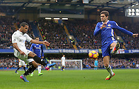 Wayne Routledge of Swansea City crosses the ball into the box under pressure from the challenging Marcos Alonso of Chelsea during the Premier League match between Chelsea and Swansea City at Stamford Bridge, London, UK. Saturday 25 February 2017