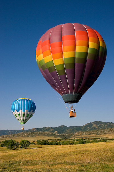 Hot air balloons at Chatfield Reservoir, southwest Denver, Colorado, USA. John offers private photo tours of Denver, Boulder and Rocky Mountain National Park. .  John offers private photo tours in Denver, Boulder and throughout Colorado. Year-round.