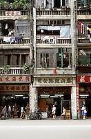 Hong Kong: Storefronts and apartments above. Photo '81.