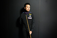 CHINA. Beijing. Hong Kong snooker player Marco Fu backstage just before going to play at the China Snooker Open. Snooker is a cue sport played on a large table measuring 3.6 metres x 1.8 metres. Originating in India in the late 19th Century where it was invented by British Army officers, the game has been a mainstay in British sport over the past few decades. Recently however, popularity of the sport has declined as the sport struggles to compete with other popular sports. The sport is however flourishing in countries such as China, where it is now the second most popular sport, behind Basketball. In a country where the  players are treated like movie-stars, China may be the great hope for the sports recovery. 2009