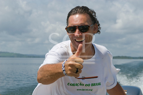 Pará State, Brazil. Xingu River. Patrick Cunningham at the helm of the Coração do Brasil.