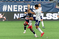 FOXBOROUGH, MA - APRIL 24: Wilfrid Kaptoum #5 of New England Revolution and Yamil Asad #11 of D.C. United battle for the ball during a game between D.C. United and New England Revolution at Gillette Stadium on April 24, 2021 in Foxborough, Massachusetts.