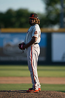 San Jose Giants relief pitcher Rodolfo Martinez (40) looks to his catcher for the sign during a California League game against the Modesto Nuts at John Thurman Field on May 9, 2018 in Modesto, California. San Jose defeated Modesto 9-5. (Zachary Lucy/Four Seam Images)