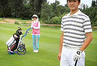 CHINA. Peter Fu (16) poses for a photograph on one of the fairways at Huatang International Golf Club in Beijing. 2009