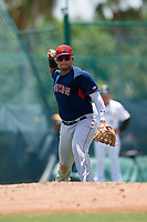 GCL Red Sox third baseman Danny Diaz (15) throws to first base during a Gulf Coast League game against the GCL Pirates on August 1, 2019 at Pirate City in Bradenton, Florida.  GCL Red Sox defeated the GCL Pirates 11-3.  (Mike Janes/Four Seam Images)