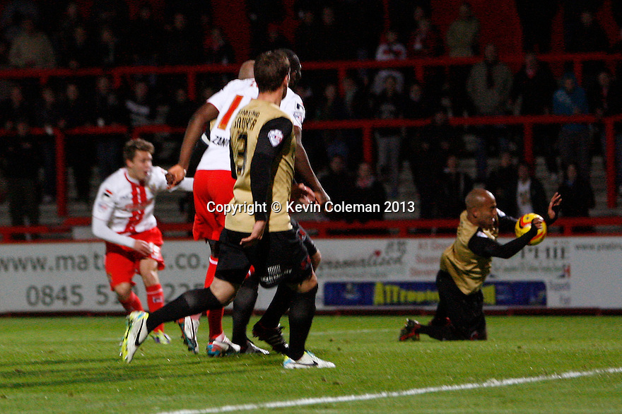 Elliot Omozusi of Leyton Orient handles the ball and concedes a penalty<br />  - Stevenage v Leyton Orient - Johnstone's Paint Trophy - Southern Section Quarter-final  - Lamex Stadium, Stevenage - 12th November, 2013<br />  © Kevin Coleman 2013