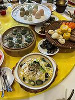 Yangzhou, Jiangsu, China.  Table Setting for Breakfast, Ye Chun Garden Tea House.  Jade Buns (green), shrimp, noodles, mushrooms, crab, assorted boiled eggs.