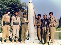 Iraq 1986.Peshmergas in Badinan,near Amadia, posing with a bomb of the Iraqi army<br />