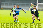 IT Tralee's Barry John Keane attempts to get forward as Evan Lowry and Josh Moore of Carlow IT keeps an eye on him, in the Sigerson Cup R1 football game in Austin Stack Park on Sunday.