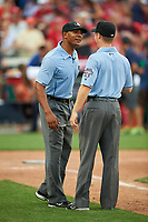 Umpires JJ January and Junior Valentine joke during the All-Star Legends and Celebrity Softball Game on July 12, 2015 at Great American Ball Park in Cincinnati, Ohio.  (Mike Janes/Four Seam Images)