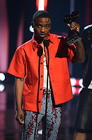 """HOLLYWOOD, CA - MAY 27: Roddy Ricch accepts Hip-Hop Artist & Song of the Year Award at the 2021 """"iHeartRadio Music Awards"""" airing live from The Dolby Theatre in Los Angeles, Thursday, May 27 (8:00-10:00 PM ET live / PT tape-delayed) on FOX.  (Photo by Frank Micelotta/FOX/PictureGroup)"""