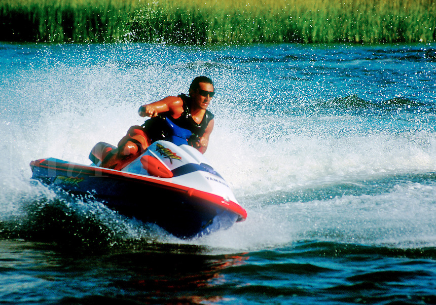 Man riding on a jet ski recreational vehicle.