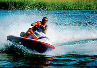 Man riding on a jet ski recreational vehicle.
