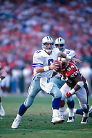 SAN FRANCISCO, CA - Quarterback Troy Aikman of the Dallas Cowboys in action during a game against the San Francisco 49ers at Candlestick Park in San Francisco, California in 1996. Photo by Brad Mangin