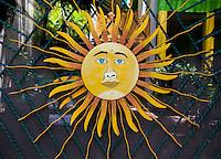Sunburst on Driveway Gate, Playa del Carmen, Riviera Maya, Yucatan, Mexico.