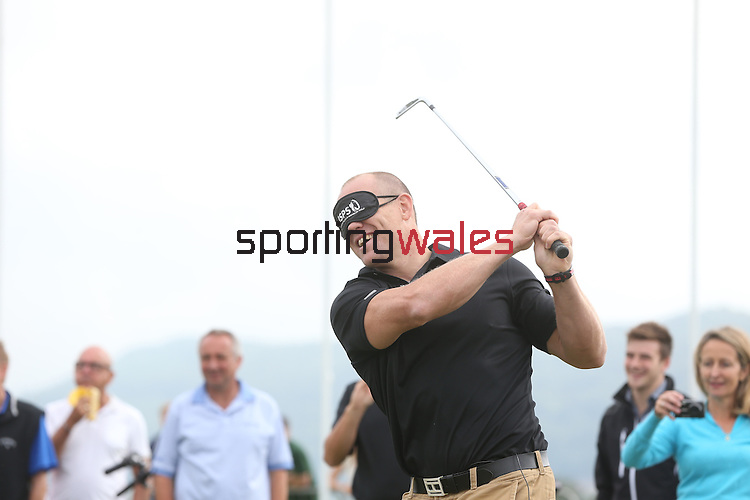 ISPS Handa Wales Open 2013<br /> Celtic Manor Resort<br /> Mike Tindall having a go at blind golf during a teaching clinch organised by tournament sponsor ISPS Handa.<br /> <br /> 28.08.13<br /> <br /> ©Steve Pope-Sportingwales