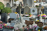 Fresh flowers adorn the burial vaults of the village cemetery, Saint-Jean-Cap-Ferrat, France