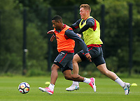 (L-R) Luciano Narsingh chased by Alfie Mawson during the Swansea City Training at The Fairwood Training Ground, Swansea, Wales, UK. Wednesday 16 August 2017